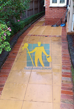 outdoor sandstone tiles pavers wet from cleaning with quarry tiles around Hazelwood Park